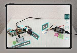 """Foto von holographischen Inhalten um den """"Miniature AR-Hub"""""""